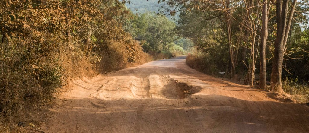 Potholes on the national road - thankfully in the dry season